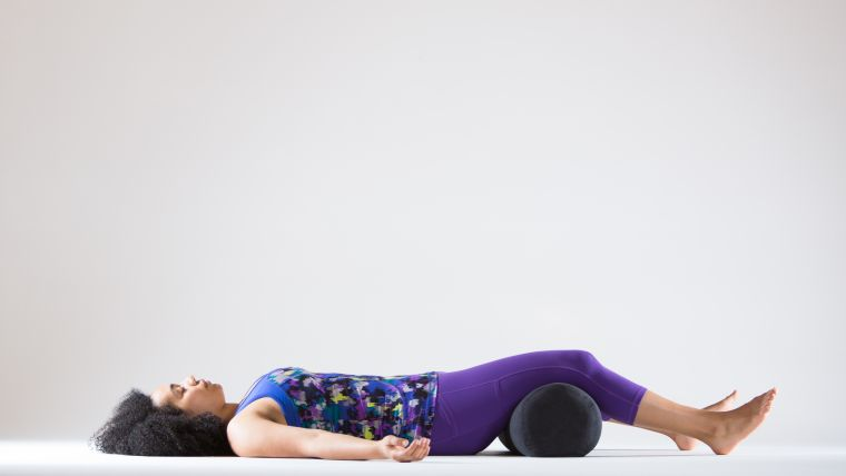 yoga for tight quads savasana with bolster