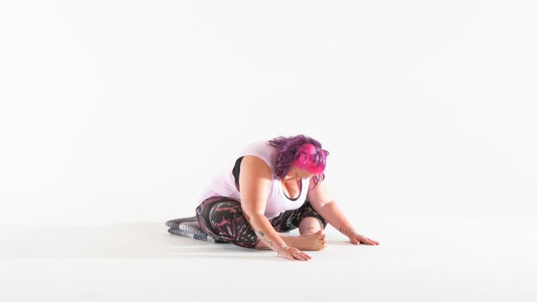 yin-yoga-forward-fold-with-toe-stretch