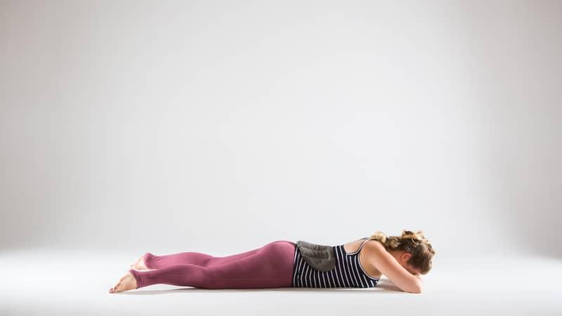 crocodile-pose-with-yoga-sandbags