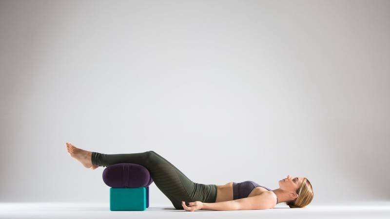 savasana-with-bolster-end-of-inversion-practice