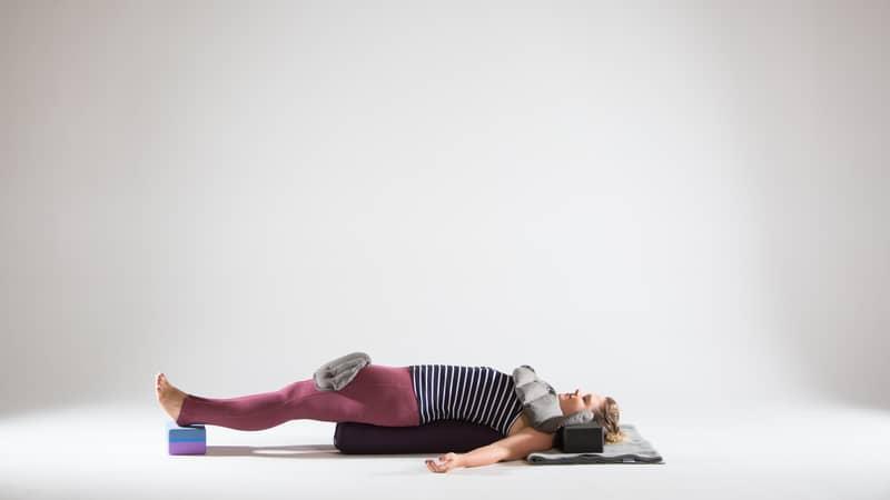 restorative-bridge-variation-with-yoga-sandbags